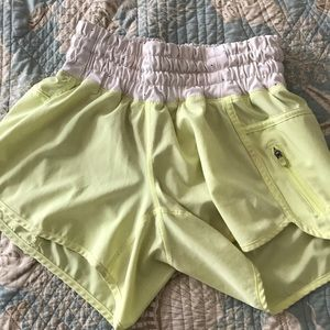 bright yellow long lulu lemon shorts size 4
